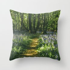 Path through wild Bluebells in ancient woodland. Wayland Wood, Norfolk, UK. Throw Pillow