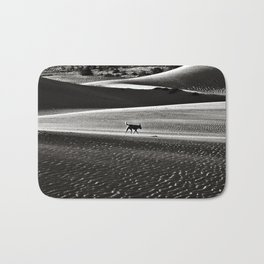 Walking alone through the desert of life Bath Mat