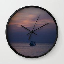 Boat at sunset Wall Clock