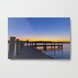Silhouette of a woman on a pier at sunet Metal Print