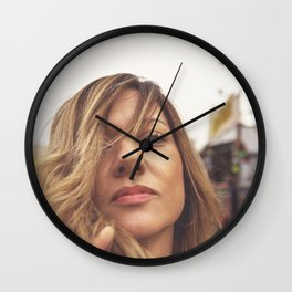 Lovely young woman in a Luna Park shortly before sunset in autumn Wall Clock