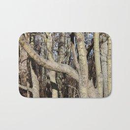 CROWDED GNARLED ASPEN TREES ON CRESCENT BEACH Bath Mat