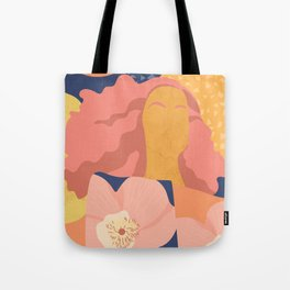 Women with eyebrow in the desert with flowery coat Tote Bag