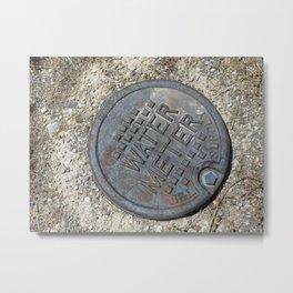 Ground | Water Meter Cap Metal Print