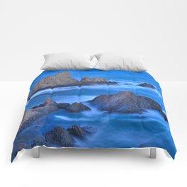Blue sunset at the singing Mermaid Reef Comforters