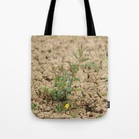 flower of life Tote Bags featuring LIFE  by Four Hands Art