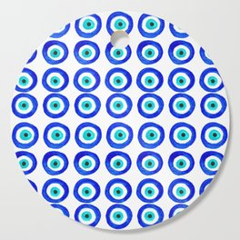 Evil Eye Amulet Talisman - on white Cutting Board