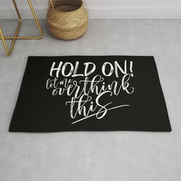 Hold on let me overthink this. (W/RQU) White on Black. Rug