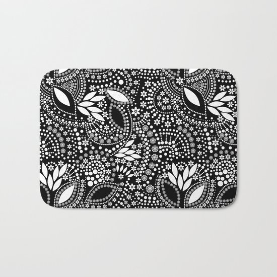 Placer of white beads on a black background . Bath Mat
