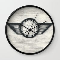 mini cooper Wall Clocks featuring Mini Cooper Logo by SummerIllustrations