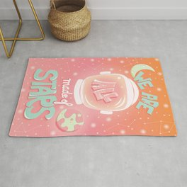 We are all made of stars, typography modern poster design with astronaut helmet and night sky, pink Rug