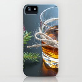 Whisky in glass with natural jute hemp cord ribbon bow on dark background iPhone Case