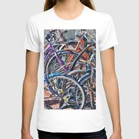 bicycles T-shirts featuring Lots of colorfull bicycles by Claude Gariepy