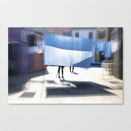 Blue bedsheet on the city street Canvas Print