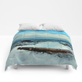 Spring Comes to the Beach in Ice that glows Blue Comforters