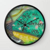 not all who wander Wall Clocks featuring Wander by Aimée Wheaton Mixed Media Art & Design