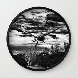 clouds at play in a small country town Wall Clock