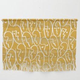 faces / mustard Wall Hanging