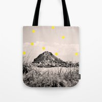 monkey island Tote Bags featuring Island by the penny drops