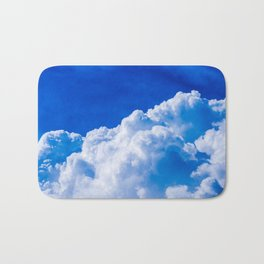White clouds in the blue sky Bath Mat