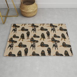 Black and Tan Coonhound on Tan Rug