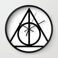 deathly hallows Wall Clocks featuring Deathly Hallows symbol by Vera