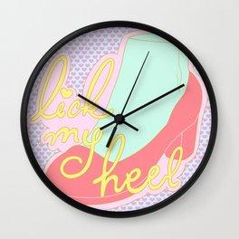 lick my heel Wall Clock