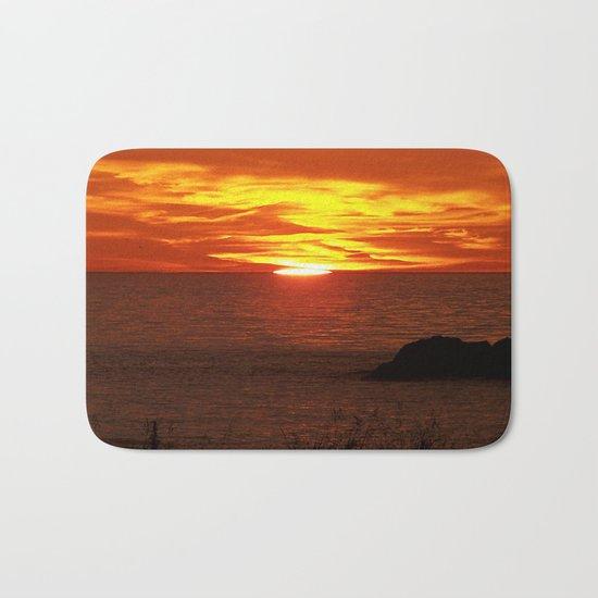 Flaming Skies Across the Sea Bath Mat