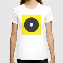 White dot on black on yellow T-shirt