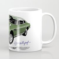 james bond Mugs featuring James Bond Aston Martin DBS from OHMSS by car2oonz