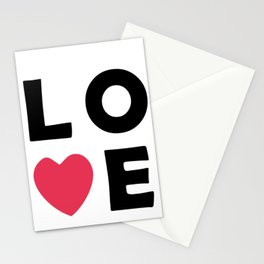 The word Love and pink heart Stationery Cards