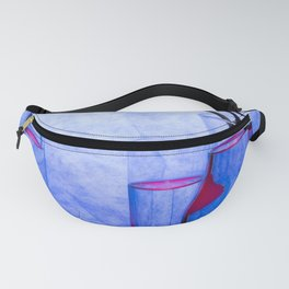 Still life with glass objects on a blue background Fanny Pack