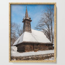 Traditional rural wooden church covered in snow Serving Tray
