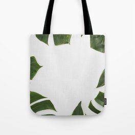 Green monstera leaves on white ink Tote Bag