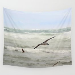 Seagulls flying over rough sea Wall Tapestry