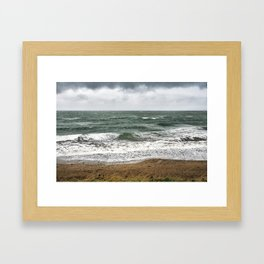 Land and sea under stormy clouds Framed Art Print