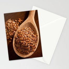 Brown linseeds portion on wooden spoon Stationery Cards