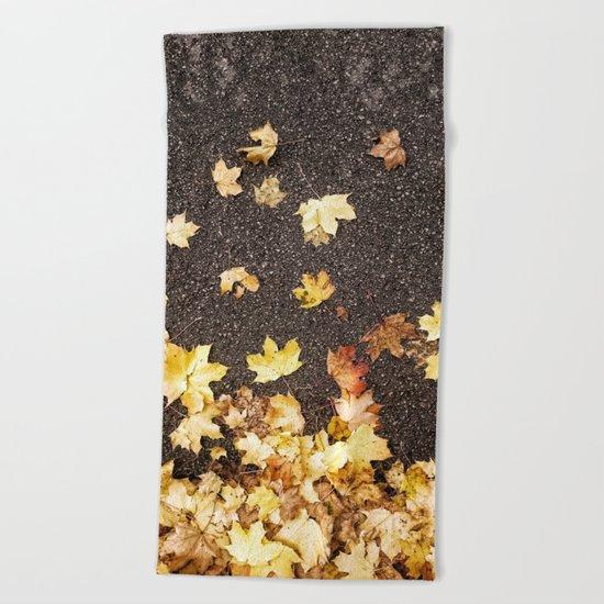 Gold yellow maple leaves autumn asphalt road Beach Towel