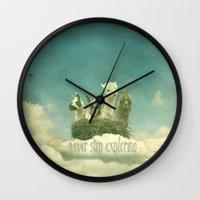 never stop exploring Wall Clocks featuring Never Stop Exploring by Monika Strigel