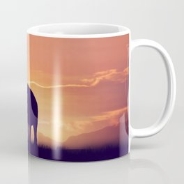 Baby and mother elephants at sunset Coffee Mug