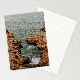 Portugese Ocean view through a cloven cliff | Peniche in Portugal Photo print  Stationery Cards