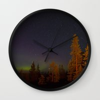 northern lights Wall Clocks featuring Northern lights by Arina Borevich