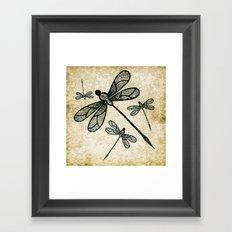 Dragonflies on tan texture Framed Art Print
