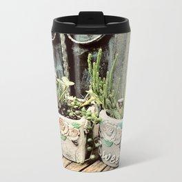 Cactus plants on coffee table Metal Travel Mug