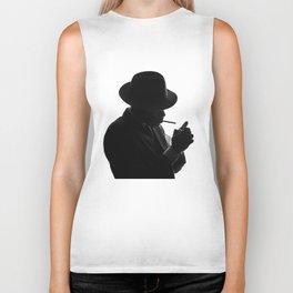 Silhouette of private detective in old fashion hat lights a cigarette Biker Tank