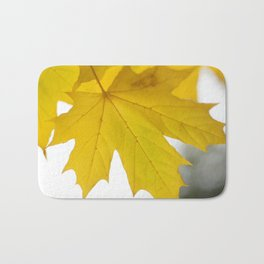 Yellow maple leaf. Bath Mat