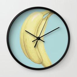 Banana in blue Wall Clock