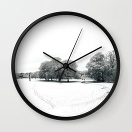 landscape view of a park cover of snow Wall Clock