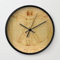 da vinci Wall Clocks featuring  Leonardo da Vinci, Vitruvian Man by Mirakyan