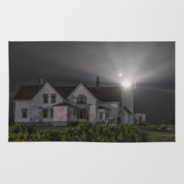 Eastern point lighthouse on a foggy night Rug